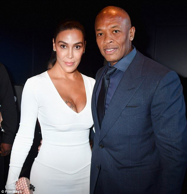 Staying close: Dr. Dre pictured with his wife Nicole Young at the premiere