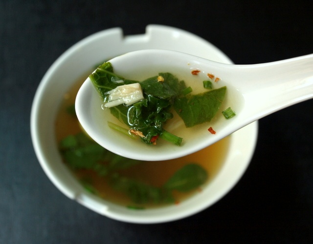 Quick Miso Soup jazzed up with roasted garlic, lemon, and greens. A healthy winter snack or starter!