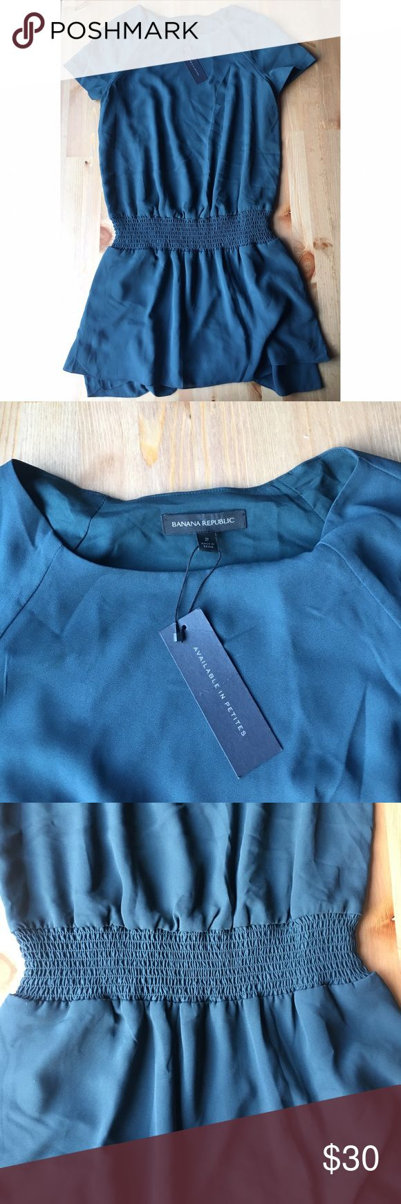 """NWT Banana Republic Dress NWT! This is a beautiful deep teal.  Has elastic dropped waist and short sleeves. Tiered ruffle skirt. 34"""" long. Perfect as a dress or as a tunic with leggings underneath! Banana Republic Dresses"""