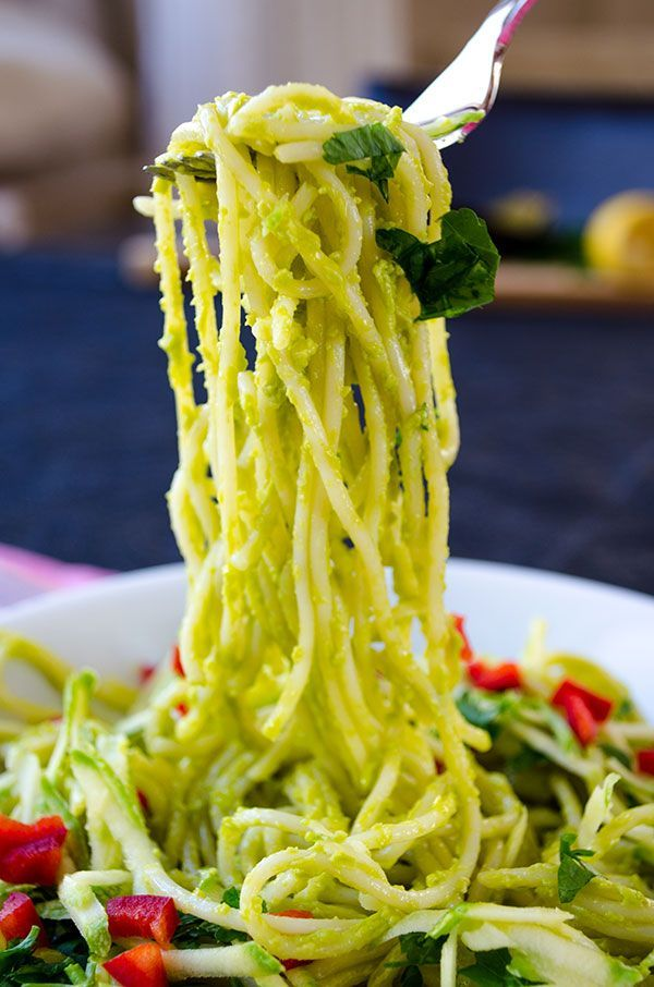 Making this guilt-free vegan creamy avocado pasta is very easy. It has no cream but so creamy and yummy! Garnish with thinly grated zucchini and red pepper. | giverecipe.com