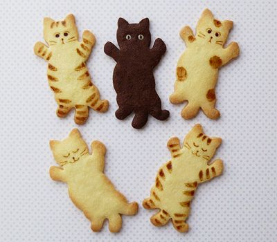 Cat-shaped cookies.....,....,....,............................... I know these are cookies but I think they would make cute pendants. They are also to cute to eat!!