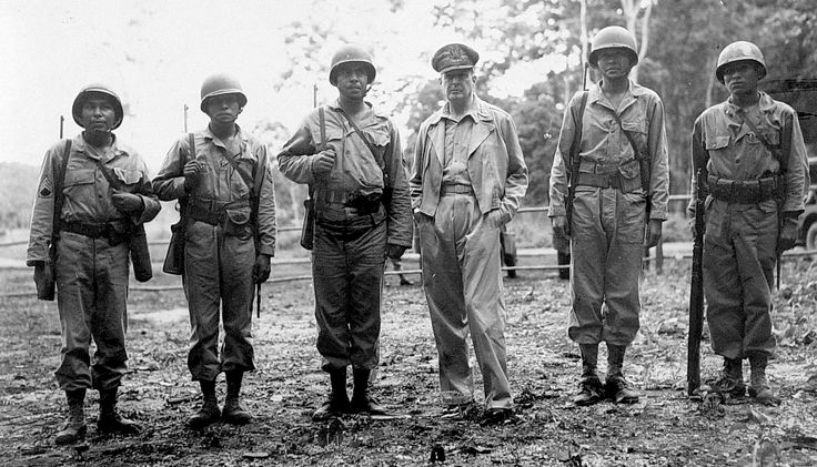 Douglas MacArthur with Native American troops somewhere in the South Pacific, late 1943