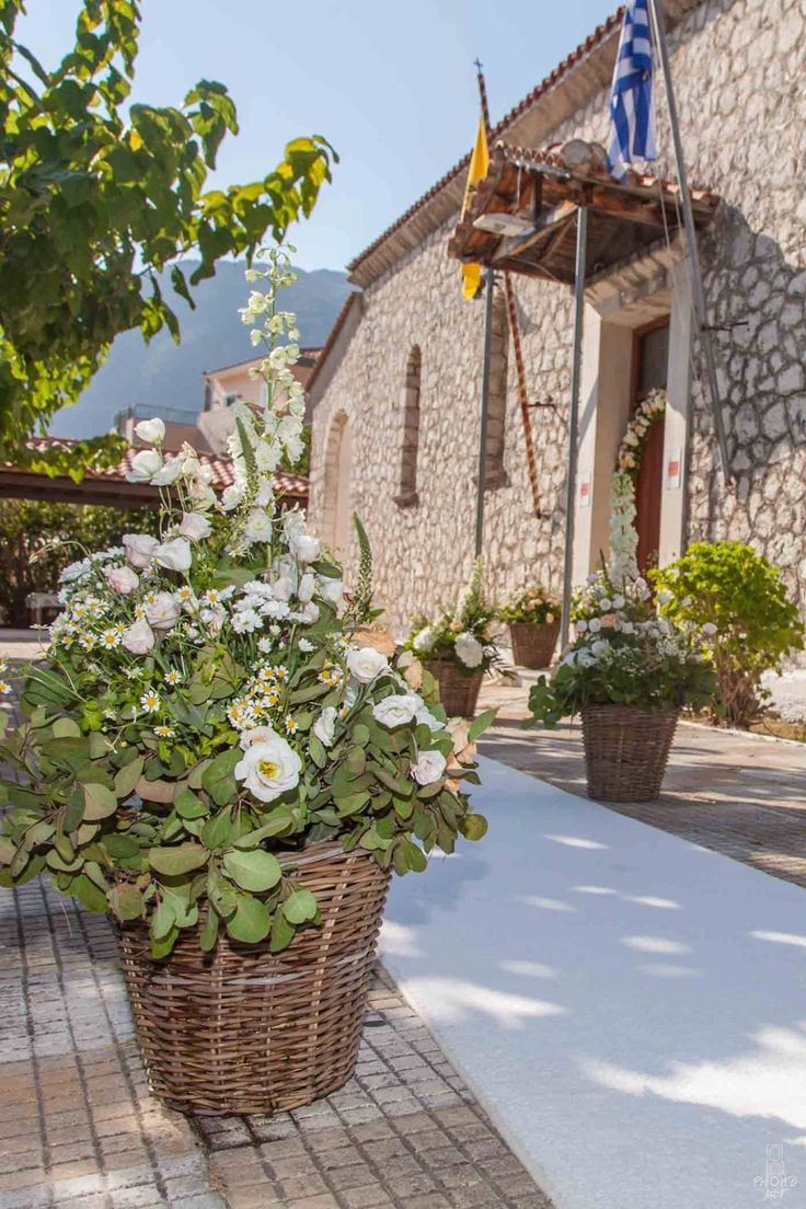 Rustic summer wedding decoration with baskets and flowers for church