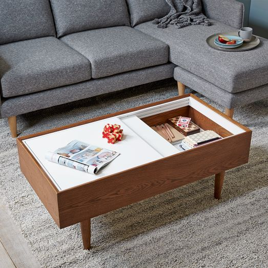 NEW! Smart, streamlined style. The top of our Double Storage Coffee Table slides open to reveal storage space below. It's great for hiding remotes, magazines or extra blankets.