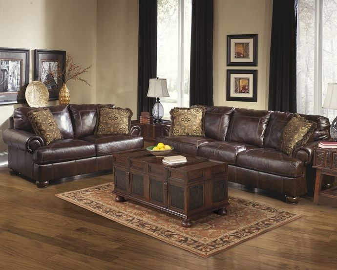 Ashley Furniture 42000 38 35 2 Pc Axiom Walnut Leather Sofa And Love Seat Set With Rounded Arms Walnut Living Room Living Room Leather Brown Couch Living Room