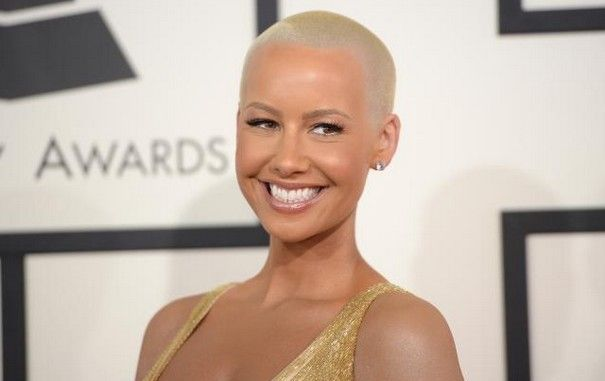 Amber Rose shows off her perfect curvy body in brown jumpsuit at Book Promotion
