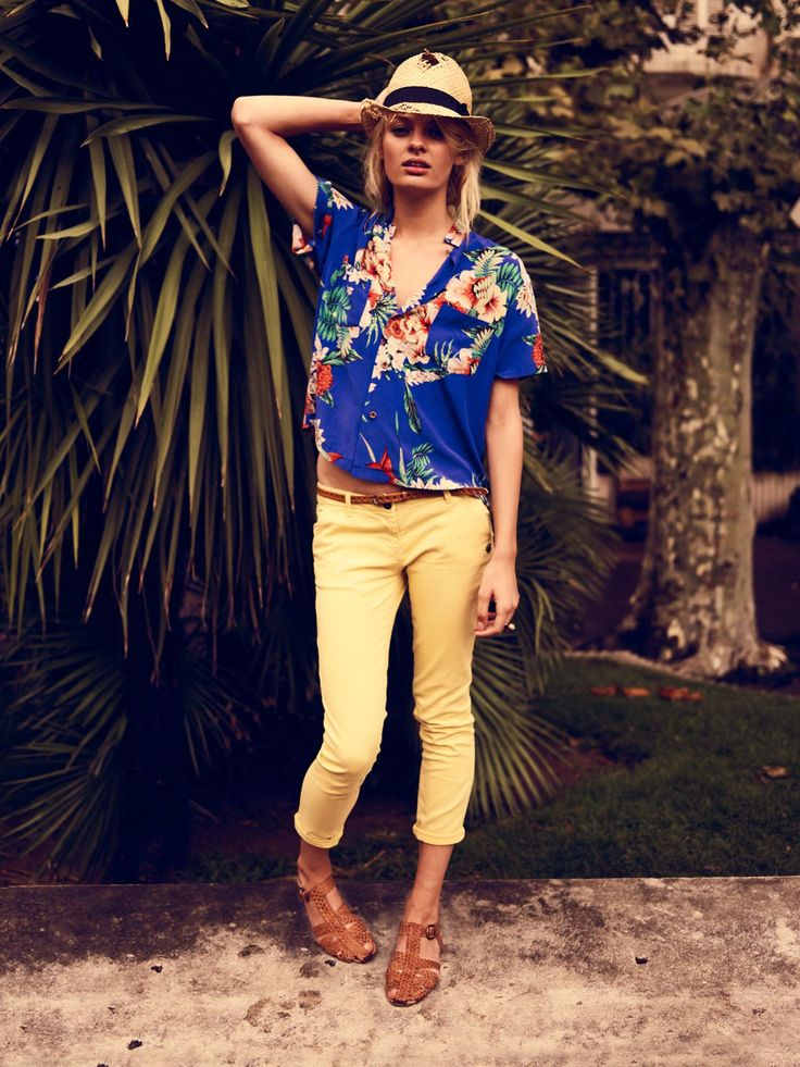 Aloha print and cropped bright jeans.