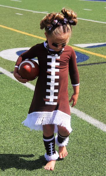 Our Football Fringe Dress is a one-of-a-kind look perfect for any little girl to cheer on her favorite team in! It features a fringe high/low bottom and 3/4 length sleeves. *Leg warmers and bows not i