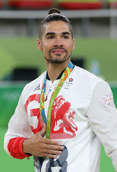 Silver medalist Louis Smith of Great Britain poses during the medal ceremony for…