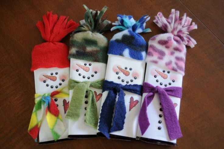 Cute snowmen with fleece scarves and hats. Chocolate bar ...