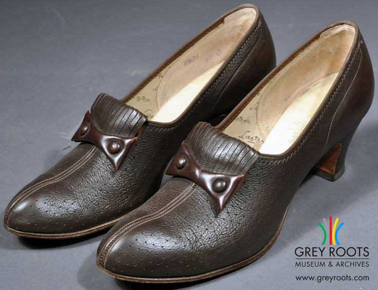 """A pair of ladies', brown leather, """"Heel Hugger"""" pumps by Murray which were purchased at Scarrow's Shoes in Owen Sound, Ontario. The leather has been perforated with many small air holes. These shoes are from the early 1960's. Grey Roots Museum & Archives Collection."""
