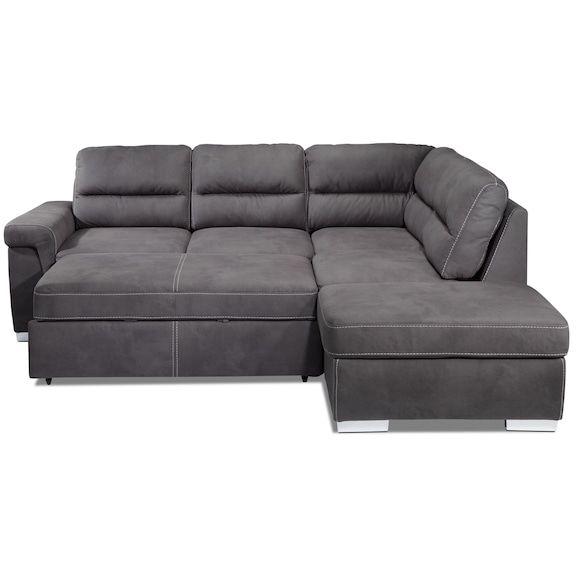 De Luxe. The Simone three-piece sectional with pop-up bed defines luxurious, spacious seating and modern elegance. Featuring a charcoal grey finish on soft, easy-care upholstery, this sectional boasts tufted backs, chic white accent stitching and block feet. A storage ottoman offers space to put blankets and living room accessories and allows you to form a right-facing chaise design, while the loveseat's hidden section folds out to create a sleeping space alongside the chaise. Three-piece...