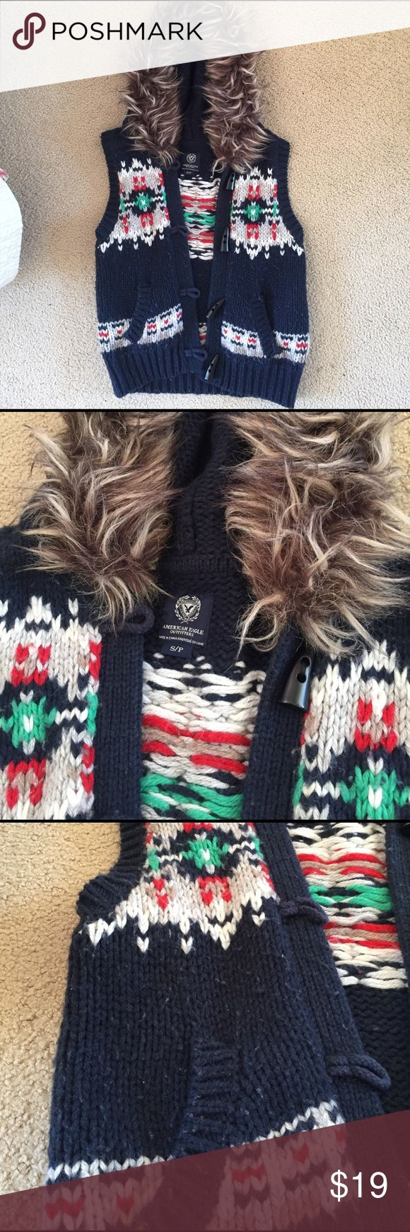 American Eagle Tribal Print Sweater Vest Tribal print sweater vest with faux fur hood lining! Pockets and super cute buttons! American Eagle Outfitters Jackets & Coats Vests