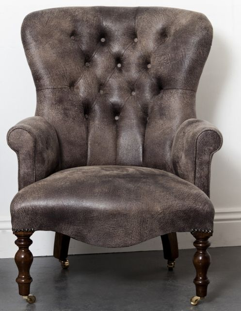 This dark soft brown faux leather button back armchair is guaranteed to please. This fabric that is soft to the touch but is durable and looks like gently worn leather