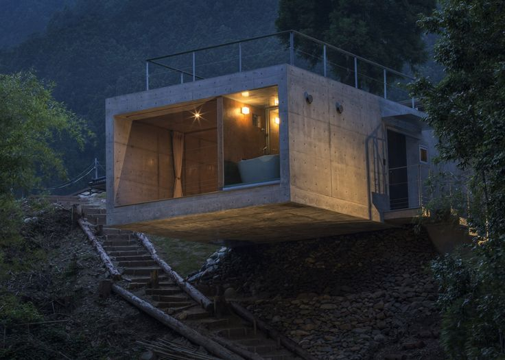 Masato Sekiya's firm Planet Creations has completed a concrete weekend house, which cantilevers six metres over a rocky ledge in Japan's Omine mountain range.