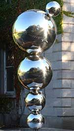 Detail of Eilís O'Connell RHA 'Apples and Atoms', Celebrating Ernest T.S. Walton 1903-95, Nobel Laureate, polished stainless steel, 2013, Trinity College Dublin Art Collections. Image courtesy and © the artist.