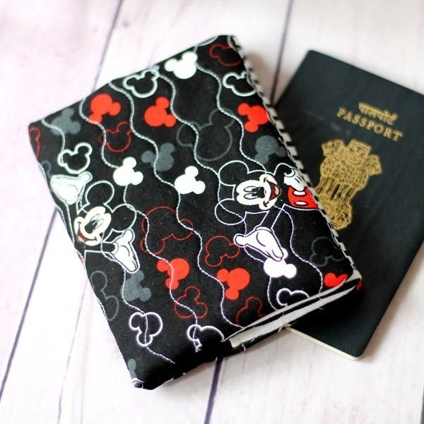 Handmade Passport Cover - Mickey Mouse Quilted Passport Cover ₹550.00 Protect your passport with this One of a kind Handmade Passport Cover. This passport cover fits most country passports. Let me know if you need to customize it.http://shop.chezvies.com/#!/Handmade-Passport-Cover-Mickey-Mouse-Quilted-Passport-Cover/p/82855216
