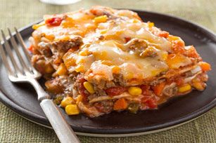 Layered Burrito Bake. Ground Beef, Salsa, Refried Beans and Cheese are layered between Tortillas.