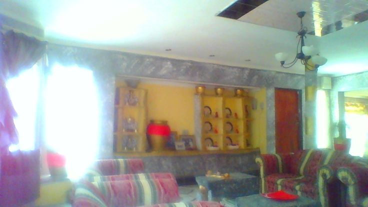 I sticked a few pink&black wall tiles on the plain white painted slab with ceiling pendant.