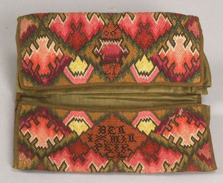 "Wool Needlework Pocketbook - Wool Needlework Pocketbook, America, 1790, double pocketbook worked in Irish stitch in a diamond pattern with geometric centers in shades of green, red, yellow and blue, cross stitch lettering ""BENJAMIN PIERCE 1790,"" olive green glazed wool lining and wool-twill tape edging, (minor losses), folded 4 5/8 x 9 in."