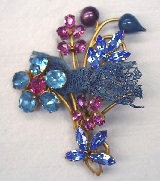 Pin.  Elsa Schiaparelli (Italian, 1890–1973).  Date: 1950s. Culture: French. Medium: glass, metal. Dimensions: Length: 3 3/4 in. (9.5 cm).