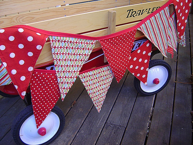 Bunting on a wagon for the guest of honor or for kiddy fun. so bright!