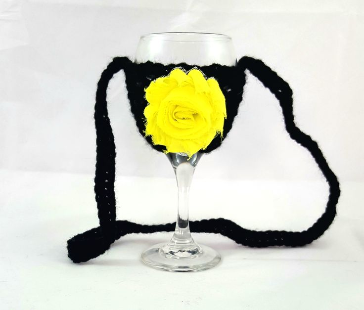 This wine glass necklace is perfect for the wine enthusiast! Fantastic stocking stuffer idea! Great for girls night out, bachelorette party, wedding favor, wine festivals, barbecues and more. No more worry about which wine glass is yours. A lovely crochet wine glass holder that sits nicely on the table or around your neck.  Created with acrylic yarn for stability and comfort.   Hand wash in cold water and hang dry to ensure long lasting wear.  *** Wine and wine glass not included ***