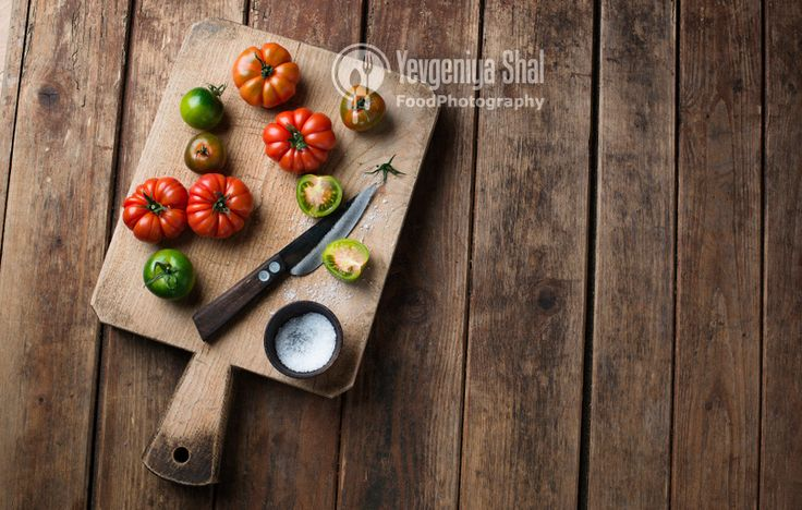 tomatoes on a cutting board with salt
