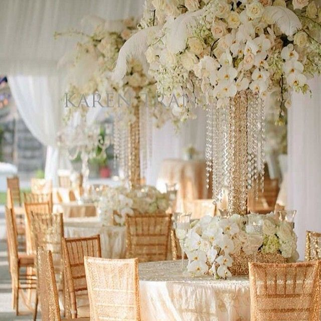 gold chair covers softened with ivory/cream florals