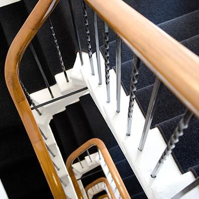 The grand and busy stairwell of this inner-city apartment building was covered with hard wearing commercial Cavalier Bremworth carpet Brazil, in a dark Parana shade. The dark tone of this carpet contrasts the white interior of the heritage building, creating a modern art deco feel.