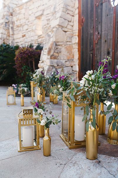 For easy and chic décor, collect empty wine bottles for vases and grab lanterns at the dollar store