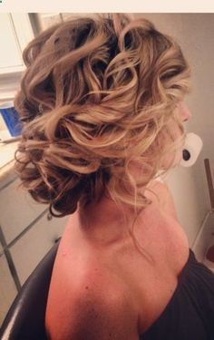 a full head of curls pulled and pinned to one side is a great way to transform a simple shape into a brilliant one.