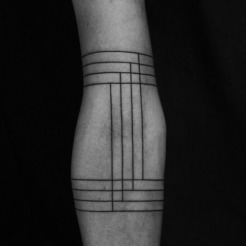 || Tattoo by Turkish tattoo artist, Okan Uçkun. Simple black lines overlapping