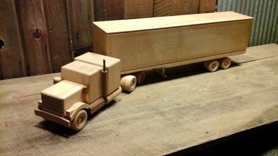 Nice vintage wooden semi truck made from hand with assorted hardwoods. This would make a great decorator or display piece. Measures 35 inches long by 5 1/2 inches wide.