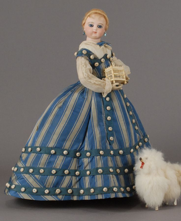 Carmel Doll Shop - Spectacular Fashion Dresses and Ensembles.check out there site they have lots of pretty dolls all out of my $ range for sure
