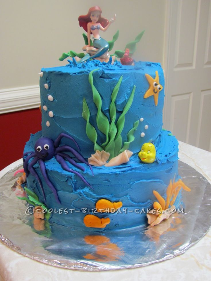 Cool Little Mermaid in an Ocean Cake... This website is the Pinterest of birthday cake ideas