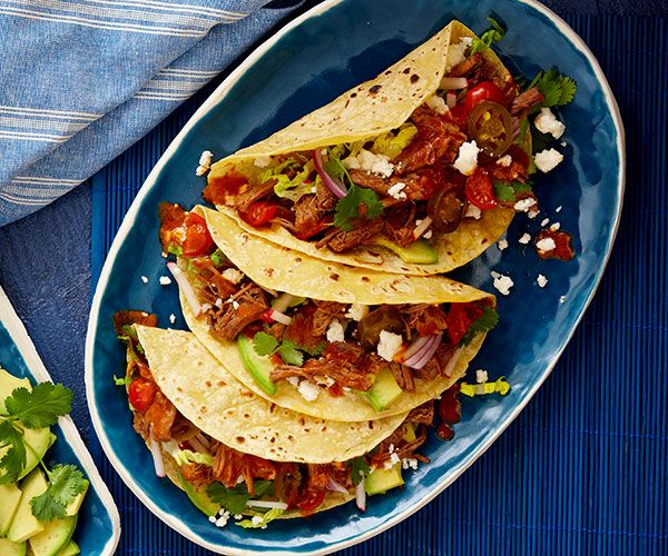 Shredded Brisket Tacos with Chipotle Dressing - this luscious, spicy taco filling is based on salpicon, a shredded or chopped cold beef salad popular in Tex-Mex cuisine | finecooking