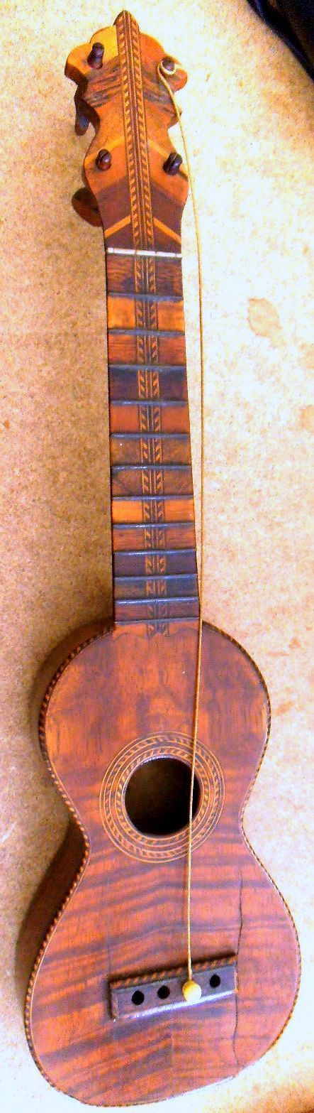 Now it does look like a nice vintage Hawaiian Ukulele from the teens and the owner is offering it for sale at $1500 but I believe from the photos its a FAKE! The big clues to me are the frets look to wide for the time the incongruities of the single gut string and loss of bridge pins but the cracks at the front have been cleated plus the perfect uncracked unworn back back also the back is bookmarked and most Ukuleles of this period would have a one piece back Finally while I am on Most…