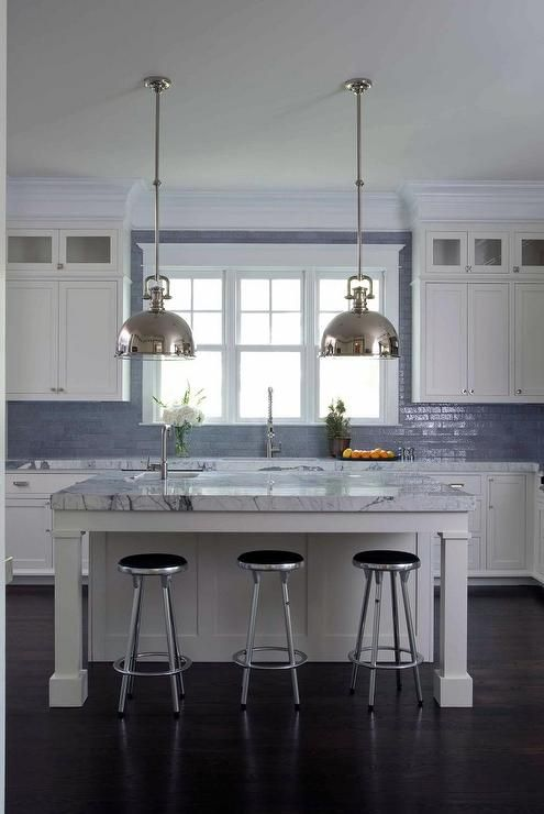 White And Blue Kitchen Features White Shaker Cabinets Paired With Gray Marble Countertops And A Glazed