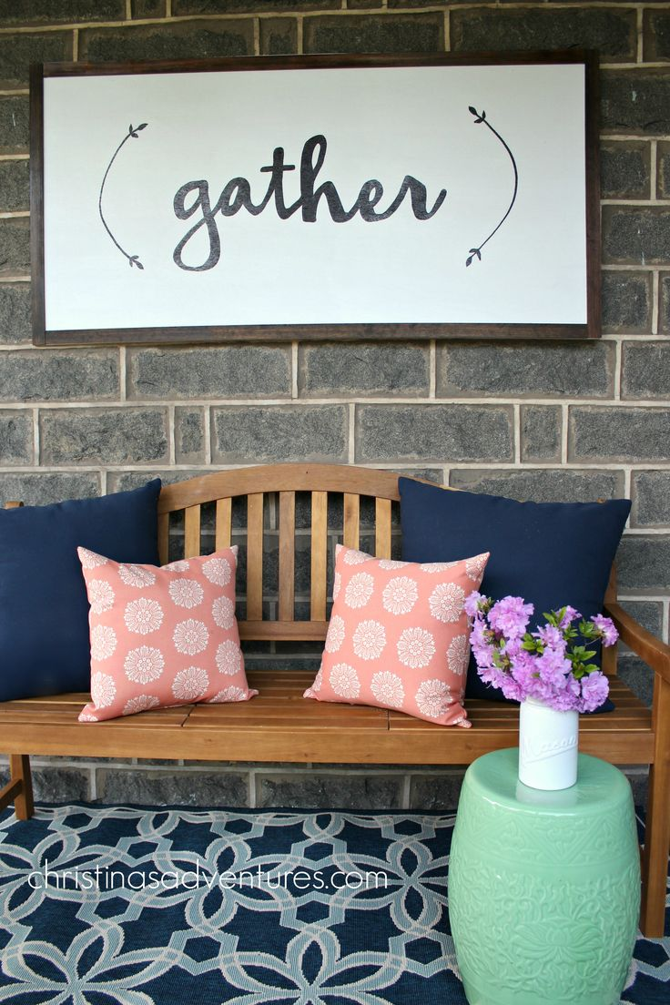 Front Porch decorating - outdoor rug, wood bench, colorful stool & a DIY wood sign