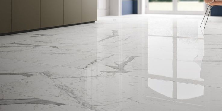 marble lab's calacatta statuario design with with white background and dramatic grey veins. available honed or polished finishes.