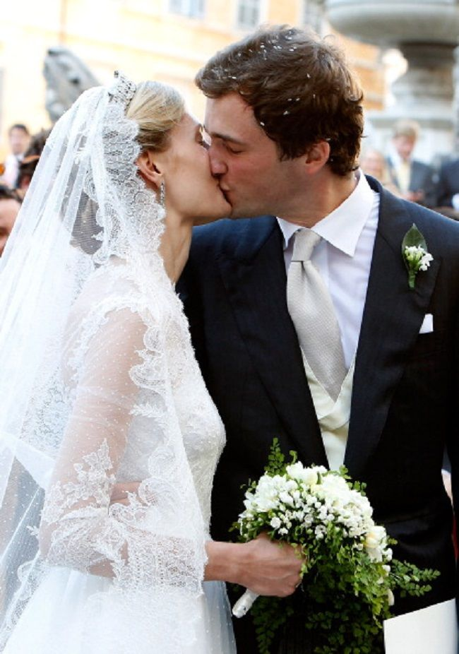Prince Amedeo of Belgium kisses the bride Princess Elisabetta Maria after their wedding ceremony at Basilica Santa Maria in Trastevere on 05.07.2014 in Rome, Italy