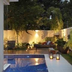Residência Quintas do Rio I: Jardins modernos por Carmen Mouro - Arquitetura de Exteriores e Paisagismo