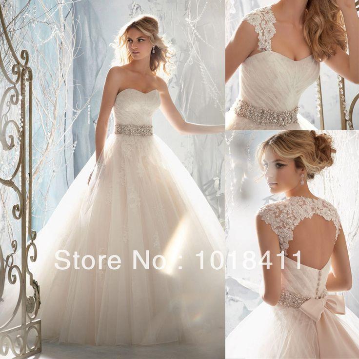 vestido de novia con espalda abierta y encaje