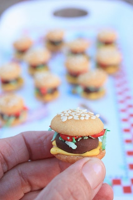 """burger bites"" cookies...tiny love!!  {mini nilla wafer buns, Hershey's Kiss hamburger patties, green coconut lettuce and red/yellow royal icing mustard and ketchup}"