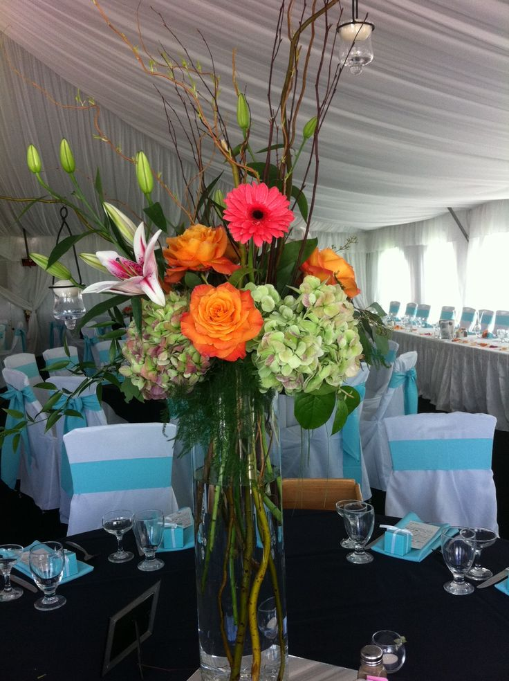 Tall Summer Centerpieces With Curly Willow Green Hydrangea Coral Gerber Daisies Stargazer