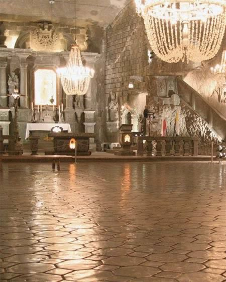 The Wieliczka Salt Mine in Krakow, Poland, has been mined continuously since the Middle Ages and miners have carved elaborate underground rooms and intricate sculptures within the Miocene salt. There is a gigantic subterannean cathedral carved entirely from salt including the floor, walls and decorations, with even the glowing chandeliers being made from salt crystals.