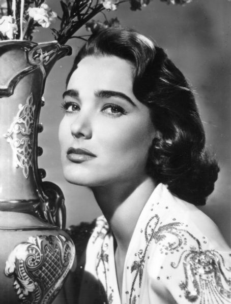 "Julie Adams, actress. Her first movie role was playing a starlet, appropriately enough, in Paramount's ""Red, Hot and Blue"" (1949), followed by a leading role in the Lippert Western ""The Dalton Gang"" (1949). Adams' first big show biz break was at Universal Studio, which changed her first name from Betty to Julia, and later to Julie."