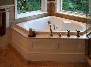 Tile corner tub and wainscoting on pinterest for Wood tile tub surround