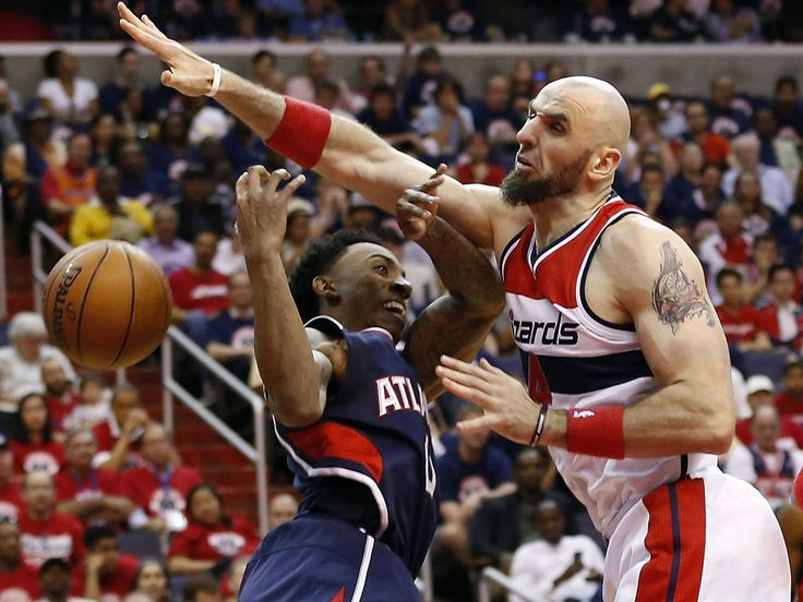 Game 1 in Washington: Wizards 103, Hawks 101 — Washington defender Marcin Gortat (4) blocks a shot attempt by Atlanta guard Jeff Teague (0).  Geoff Burke, USA TODAY Sports